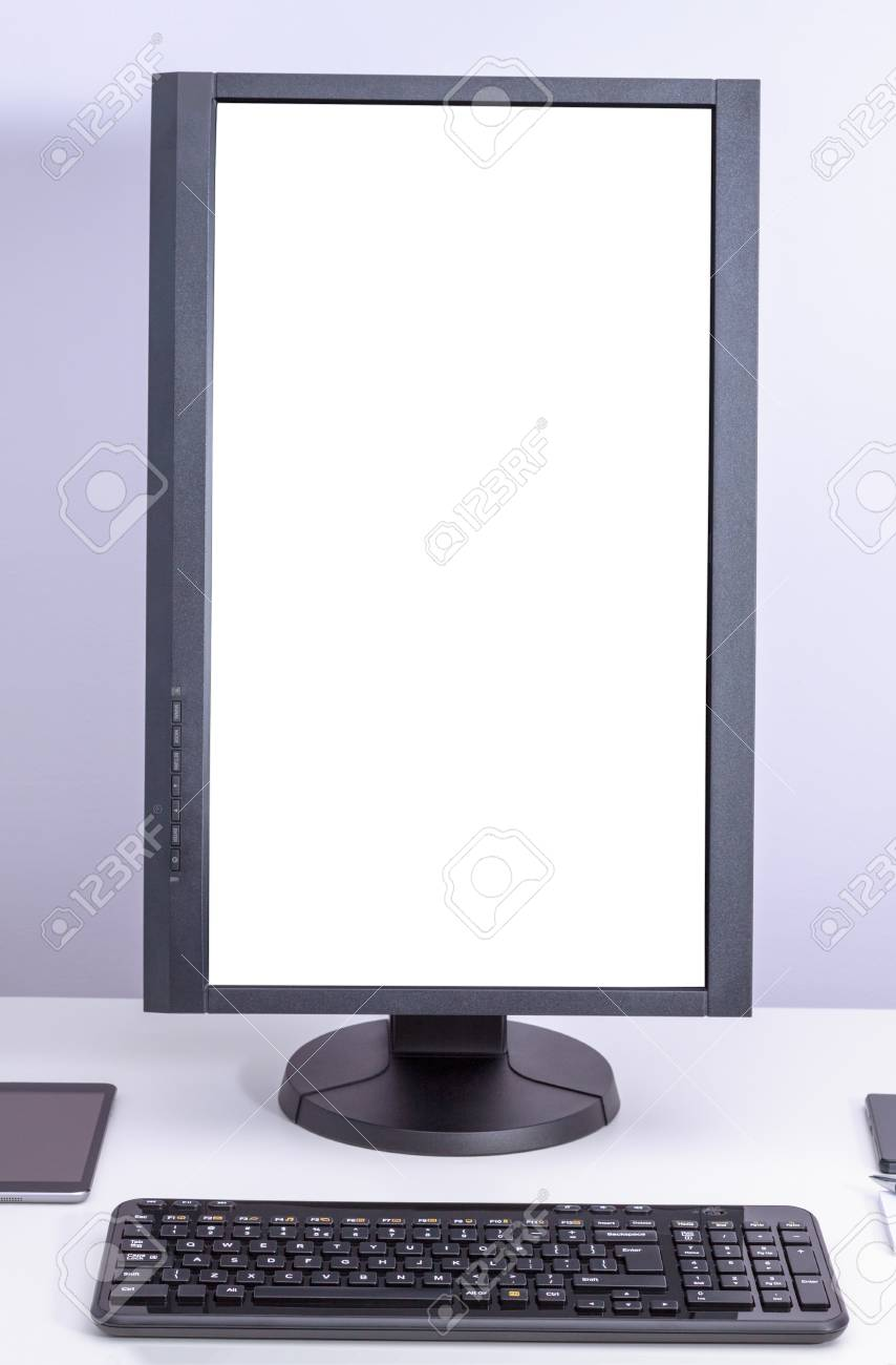 brand new 1ff6f 89e14 White blank pc monitor turned vertical and keyboard on desk.