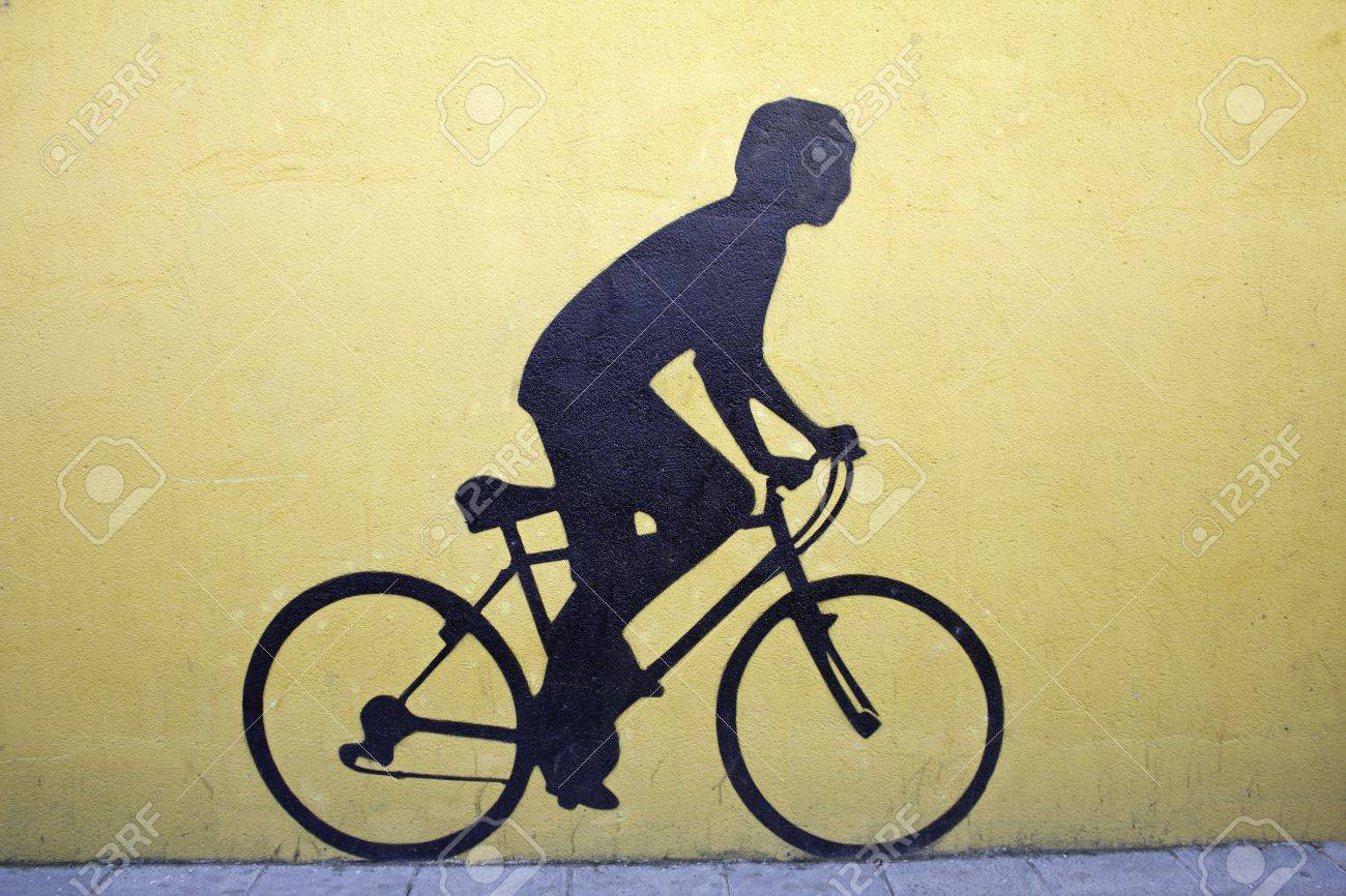 Young Woman Riding A Bike Pedalling, Silhouette Wall Art Stock Photo ...