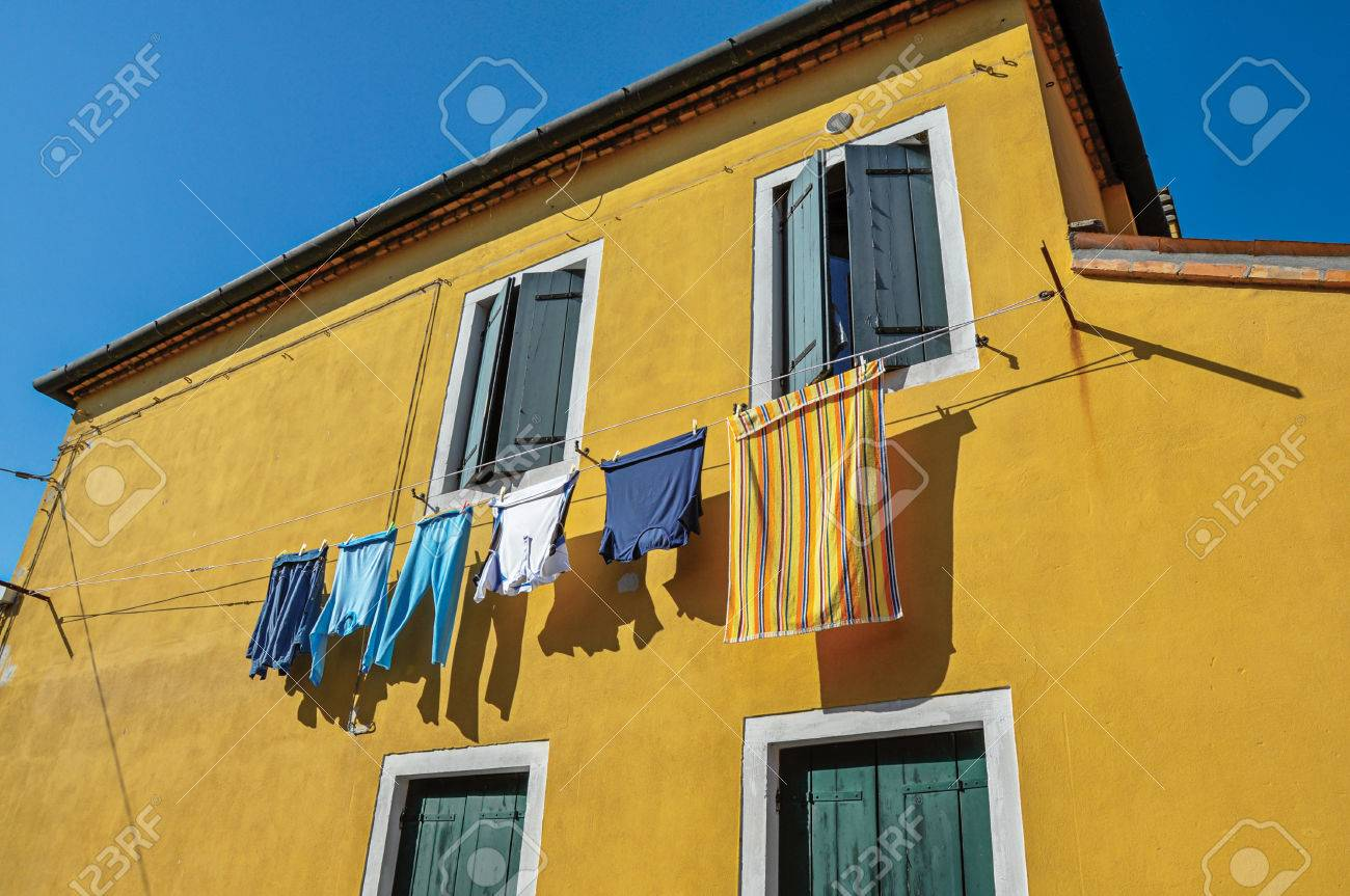 Close-up Of Windows On Colorful Walls And Clothes Hanging On.. Stock ...