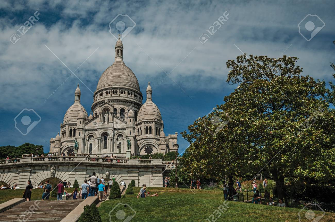 """Paris, France - July 08, 2017. People, staircase and Basilica of Sacre Coeur at Montmartre in Paris. Known as the """"City of Light"""", it is one of the world's most awesome cultural centers. Northern France. - 103249061"""