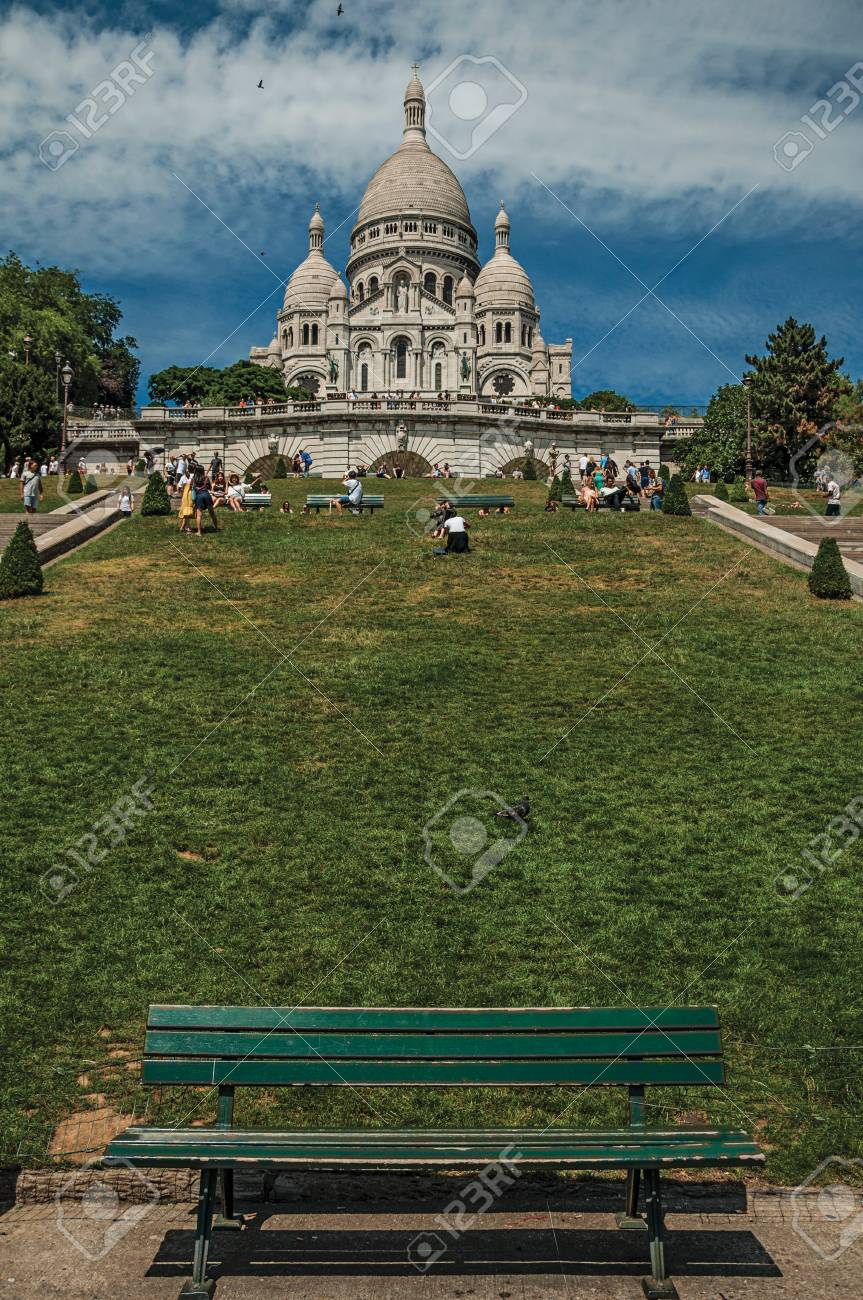 """Paris, France - July 08, 2017. People, lawn and Basilica of the Sacre Coeur at Montmartre in Paris. Known as the """"City of Light"""", it is one of the world's most awesome cultural centers. Northern France. - 103272833"""