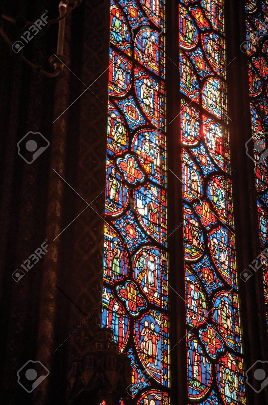 """Paris, Northern France - July 08, 2017. Detail of Stained glass window at the gothic Sainte-Chapelle (church) in Paris. Known as the """"City of Light"""", it is one of the most awesome cultural center - 103272873"""