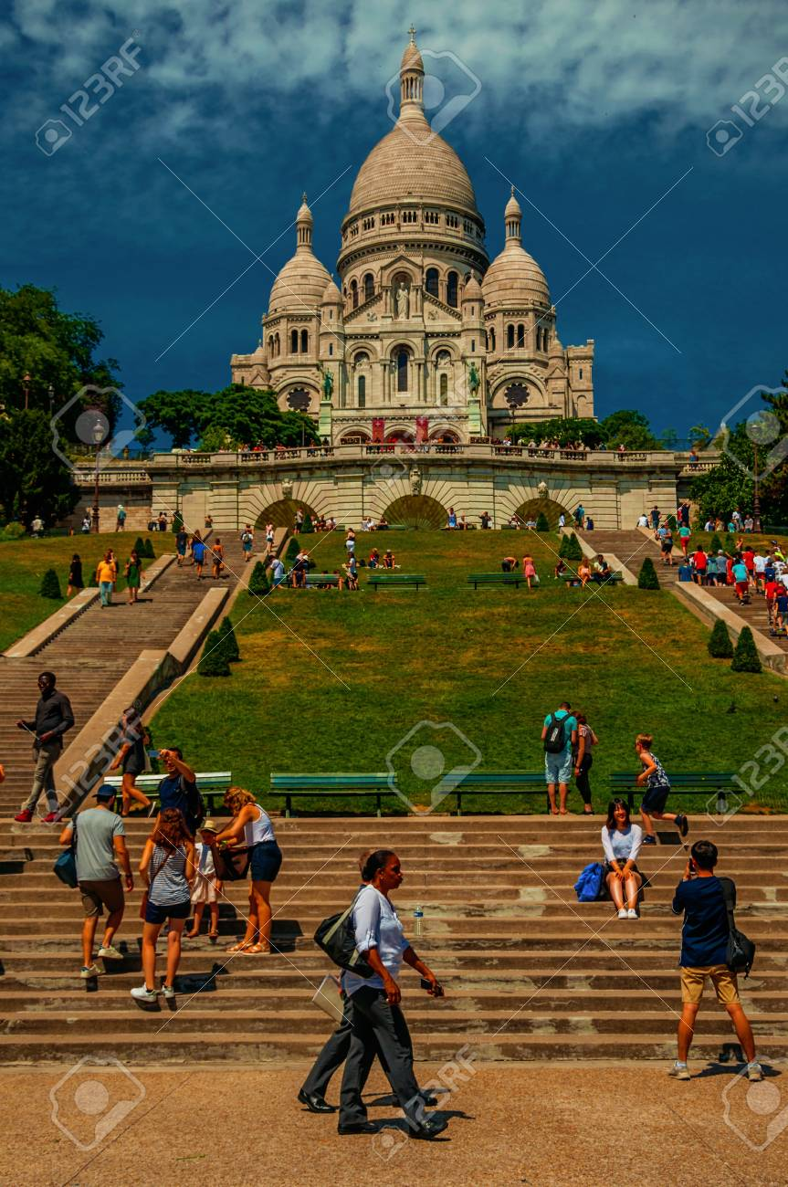 """Paris, France - July 08, 2017. People, staircase and Sacre Coeur's Basilica in Paris. Known as the """"City of Light"""", it is one of the world's most awesome cultural centers. Northern France. Retouched photo - 104133823"""
