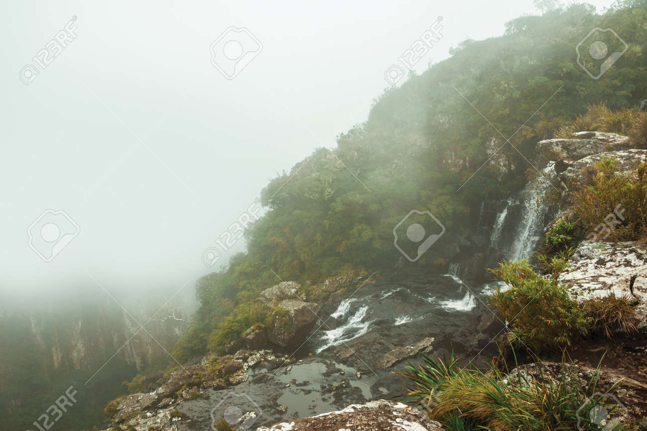 Black Tiger waterfall on cliff from a deep valley with mist at Serra Geral National Park near Cambara do Sul. A small country town in southern Brazil with amazing natural tourist attractions. - 136127270