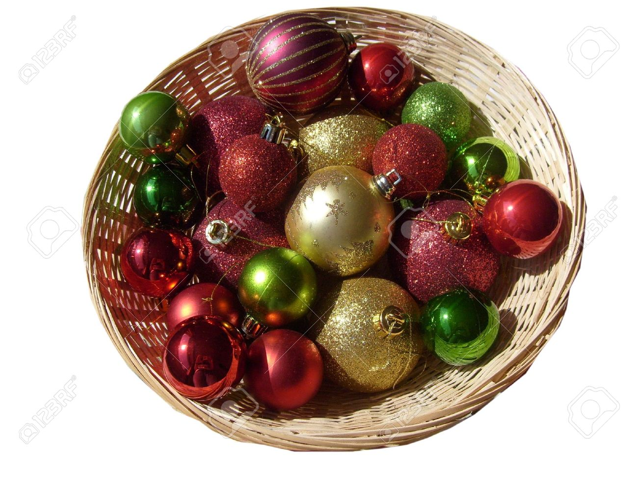 Green christmas tree with red decorations - Basket Of Red Gold And Green Christmas Tree Decorations Baubles Stock Photo 3376577
