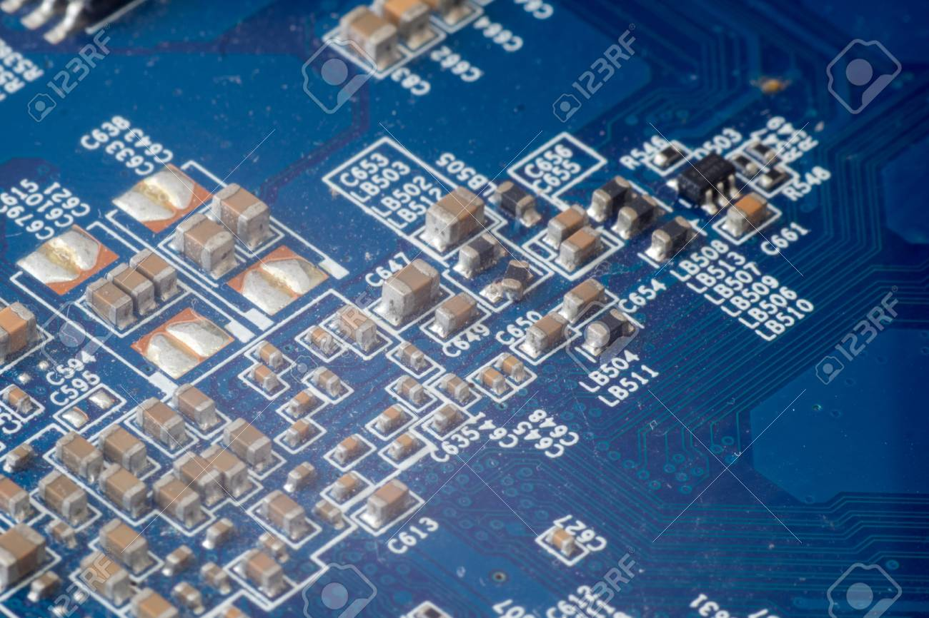 Electronic PCB printed circuit board in macro close-up with transistors