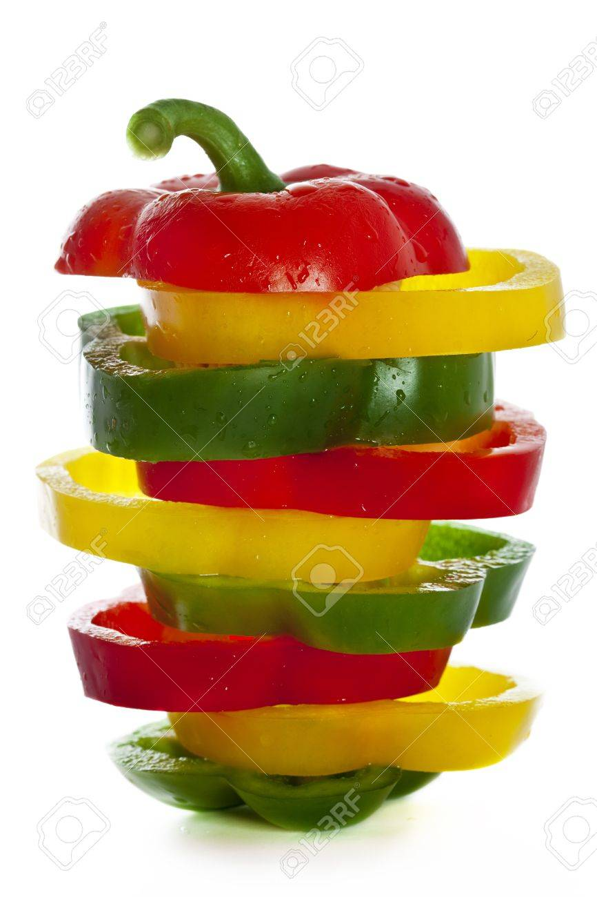 Sprinkled fresh green, yellow and red paprikas sliced and mixed. Isolated on White Stock Photo - 13555520