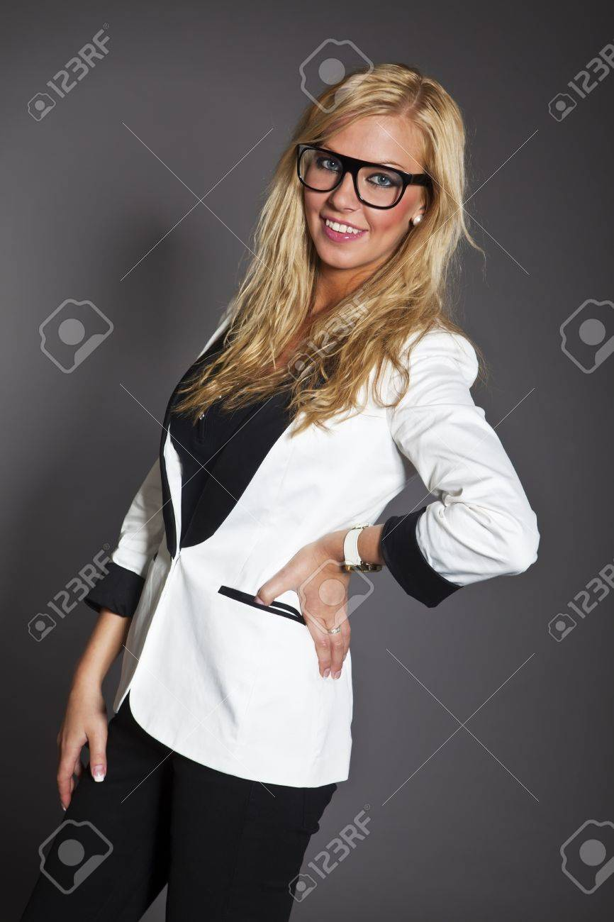 studio shot portrait of a young blond long hair caucasian business woman in smart outfit wearing glasses Stock Photo - 14461010