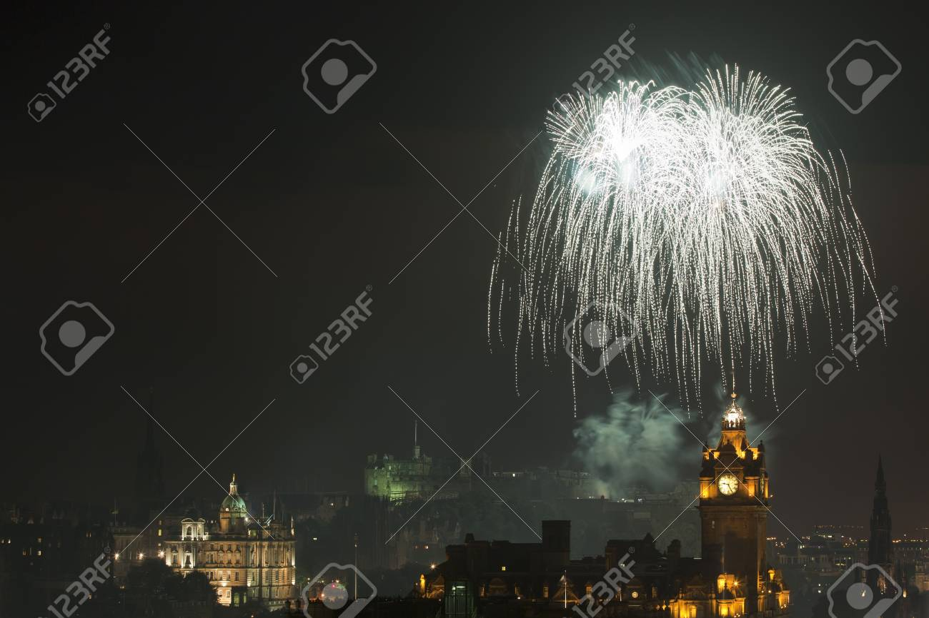 Edinburgh Cityscape with fireworks over The Castle and Balmoral Clock Tower Stock Photo - 15490307