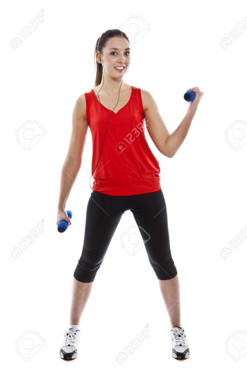 Young pretty fit woman exercising with weights while listening music. Studio Isolated on white. High key Stock Photo - 15529431