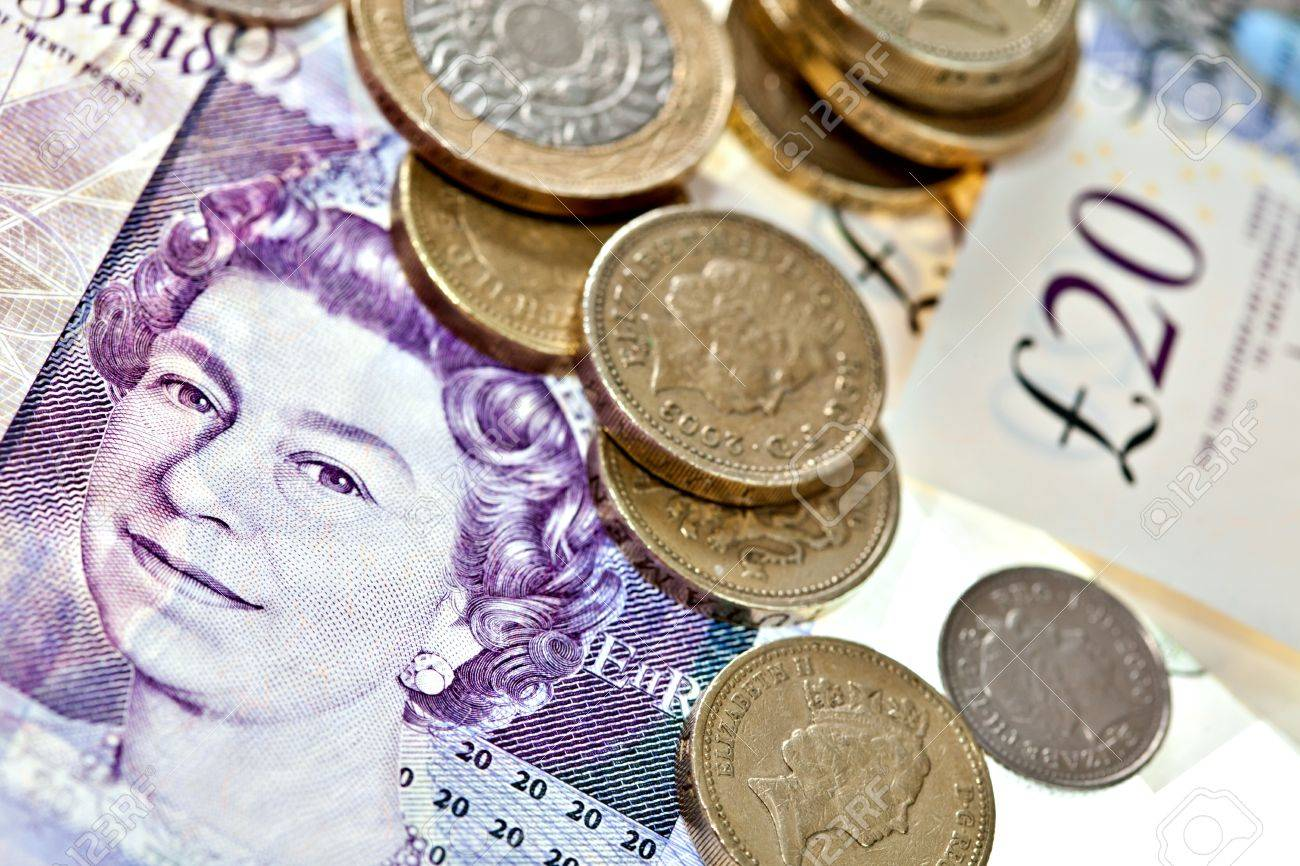 british pound sterling note: British pound sterling in coins and bank notes Macro isolated on - 17691527-British-pound-sterling-in-coins-and-bank-notes-Macro-isolated-on-white-Stock-Photo
