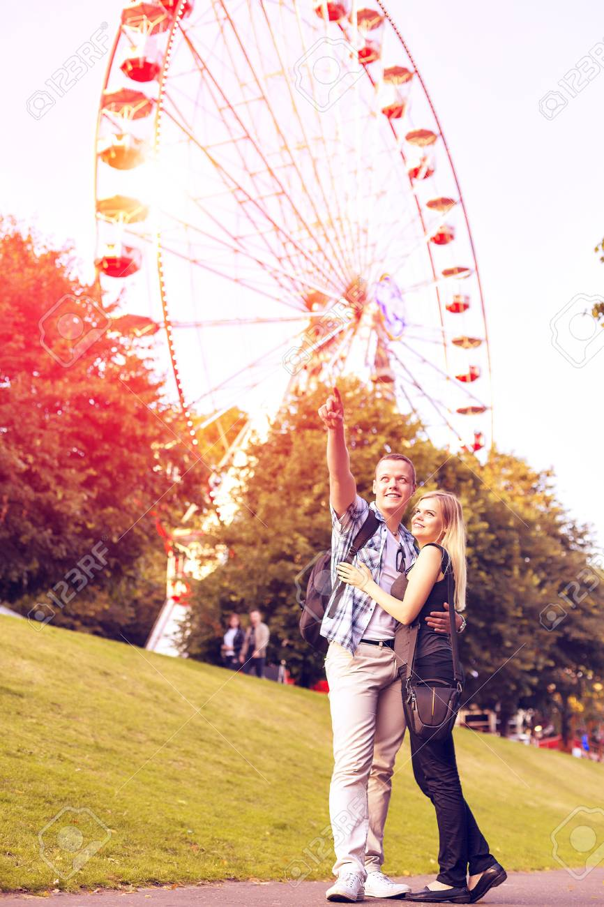 Young Couple Have Good Time In Summer Park With Ferris Wheel Stock Photo Picture And Royalty Free Image Image 71160433