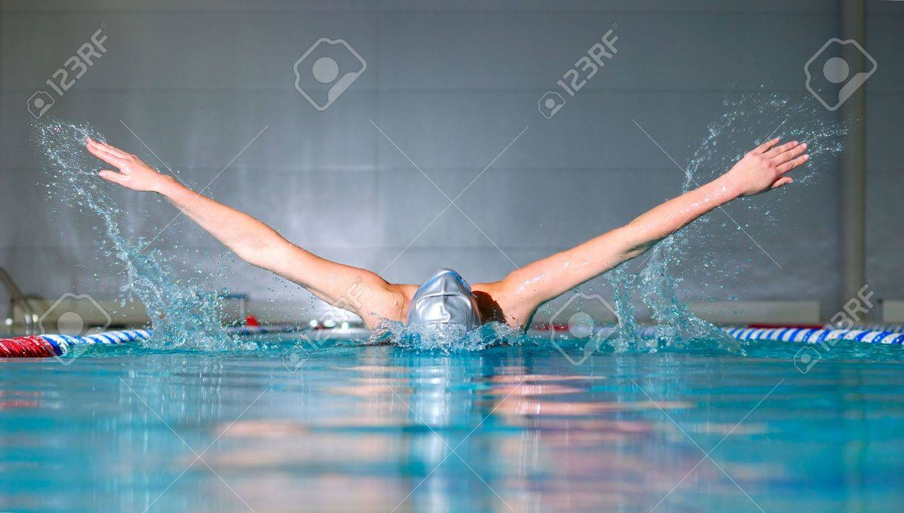 woman swims using the butterfly stroke in indoor pool Stock Photo - 6550237