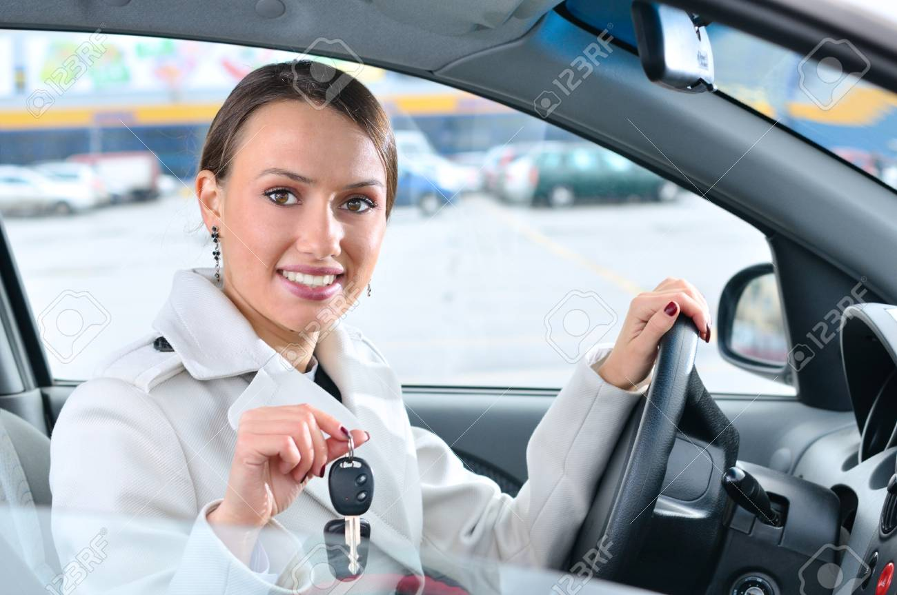 happy woman is showing keys of her new car Stock Photo - 8197731