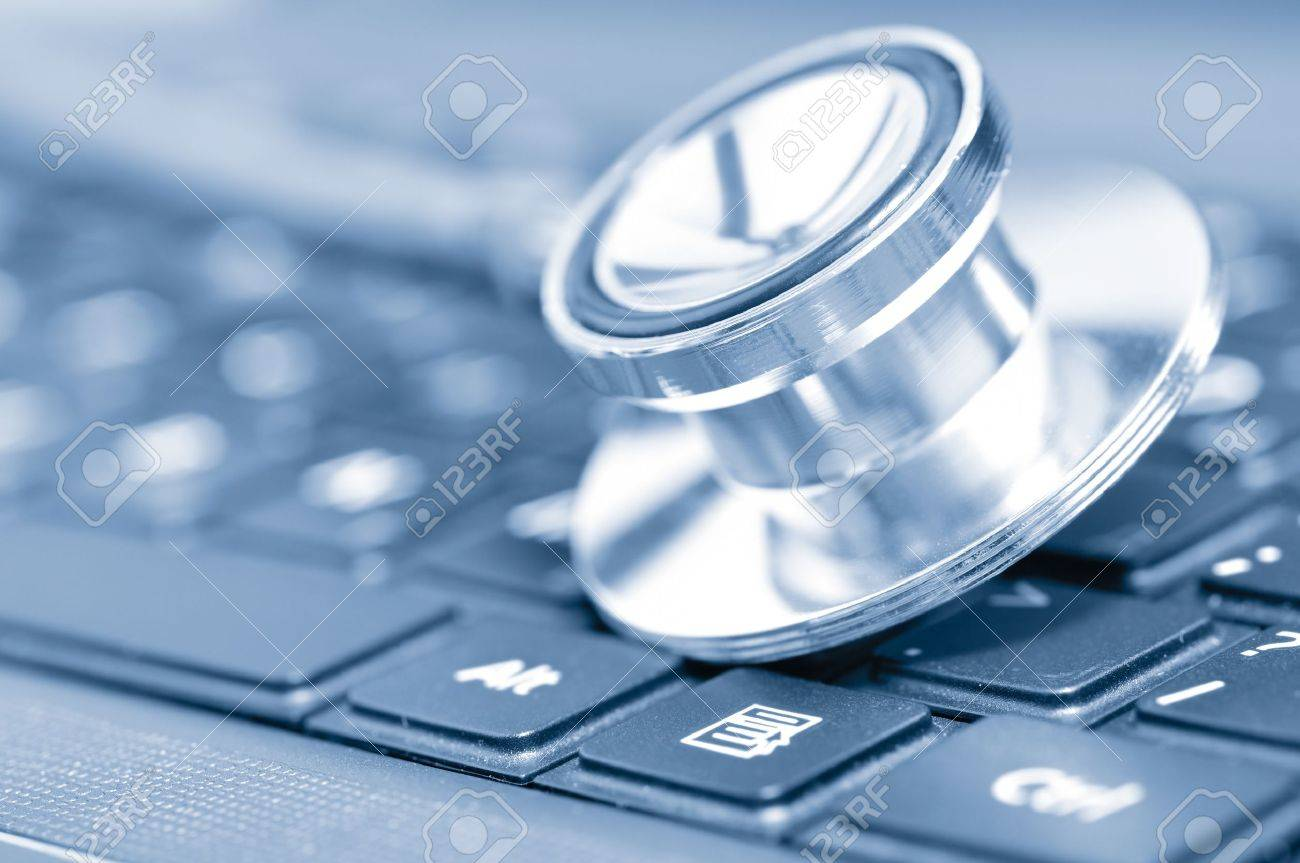closeup if a stethoscope on a computer keyboard Stock Photo - 8650415