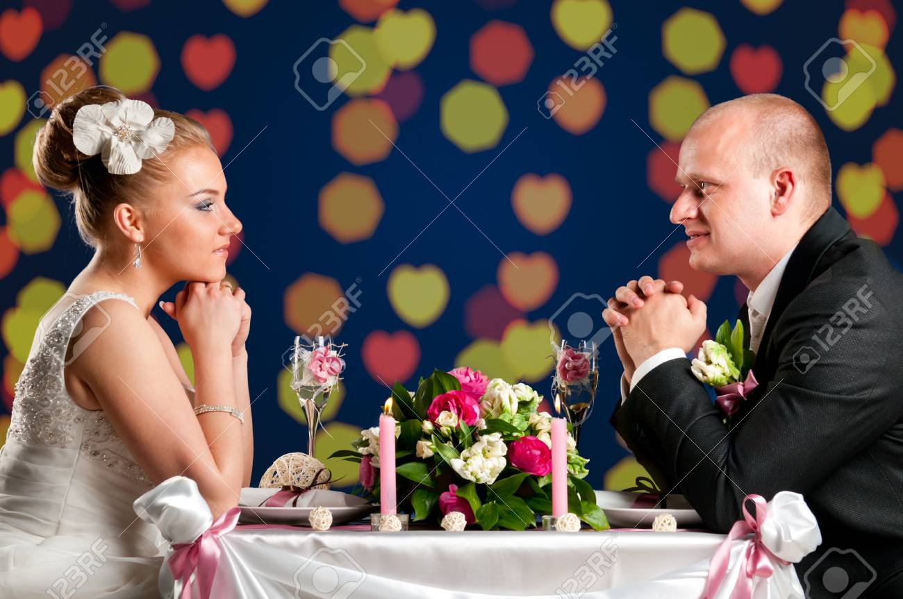bride and groom are sitting at cafe Stock Photo - 9756402