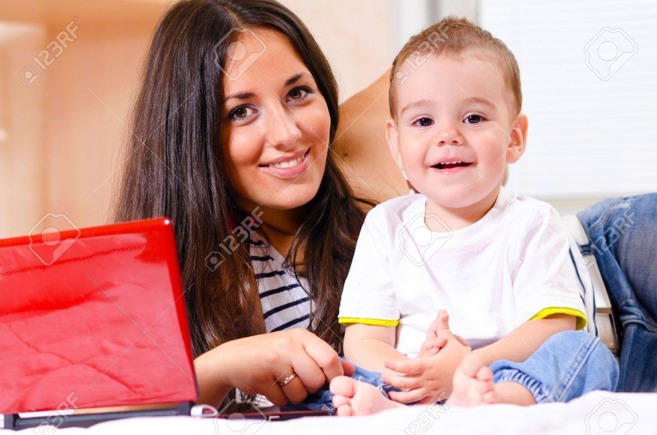 mother and son are using laptop Stock Photo - 10423806