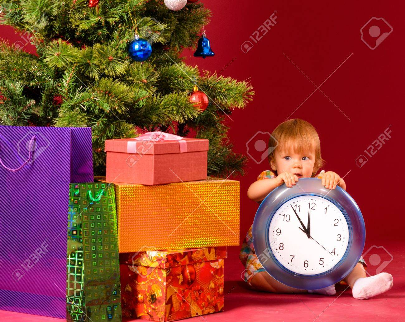 baby with clock Stock Photo - 15921685