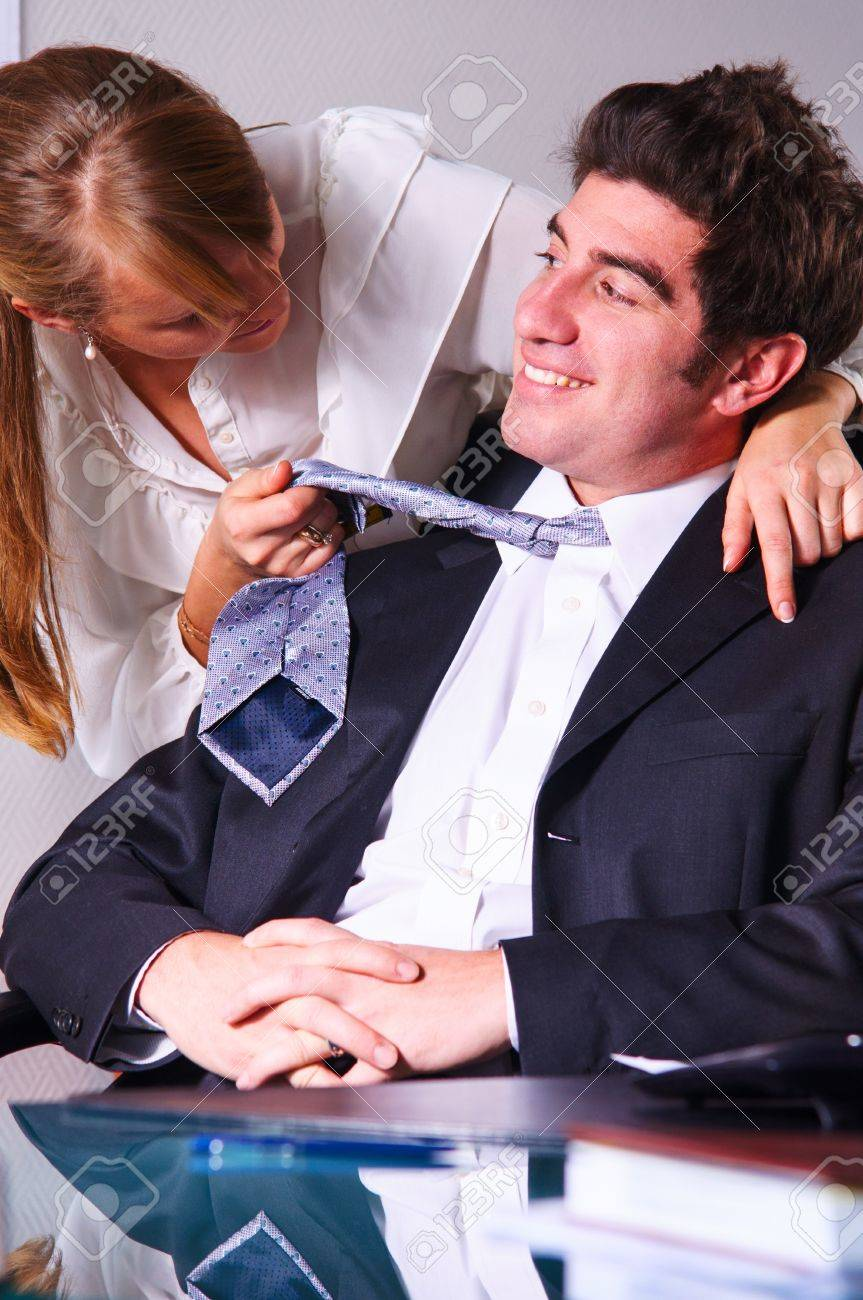 businesswoman is seducing her boss at office Stock Photo - 18706636