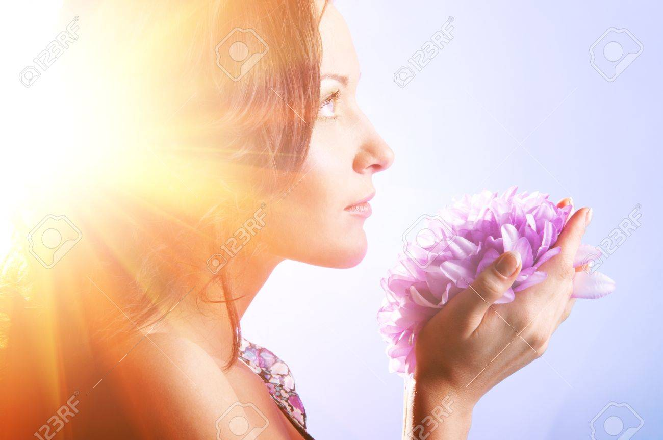 beautiful woman with big flower in sun rays Stock Photo - 18715022