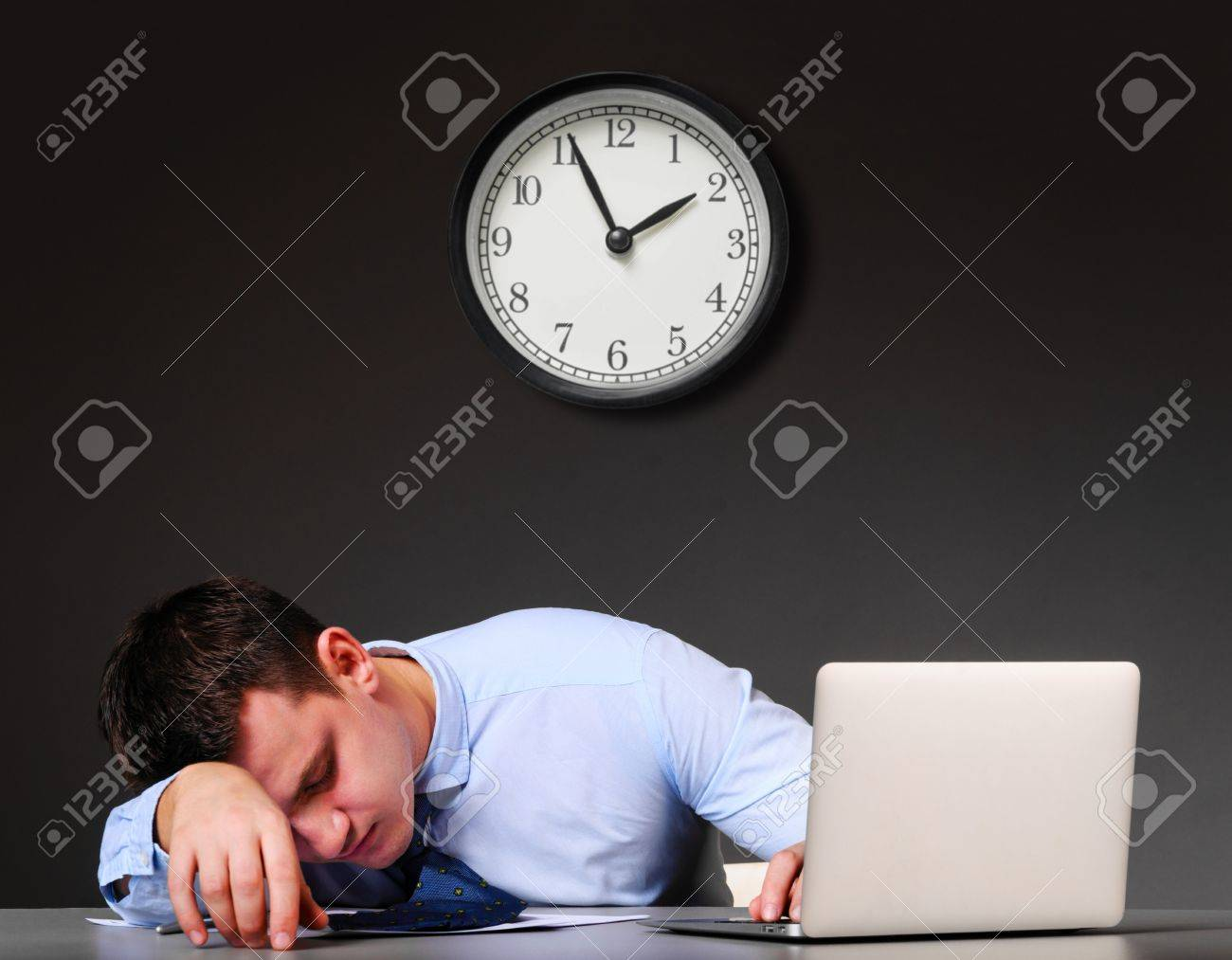 tired businessman is sleeping at his table with laptop Stock Photo - 20177675