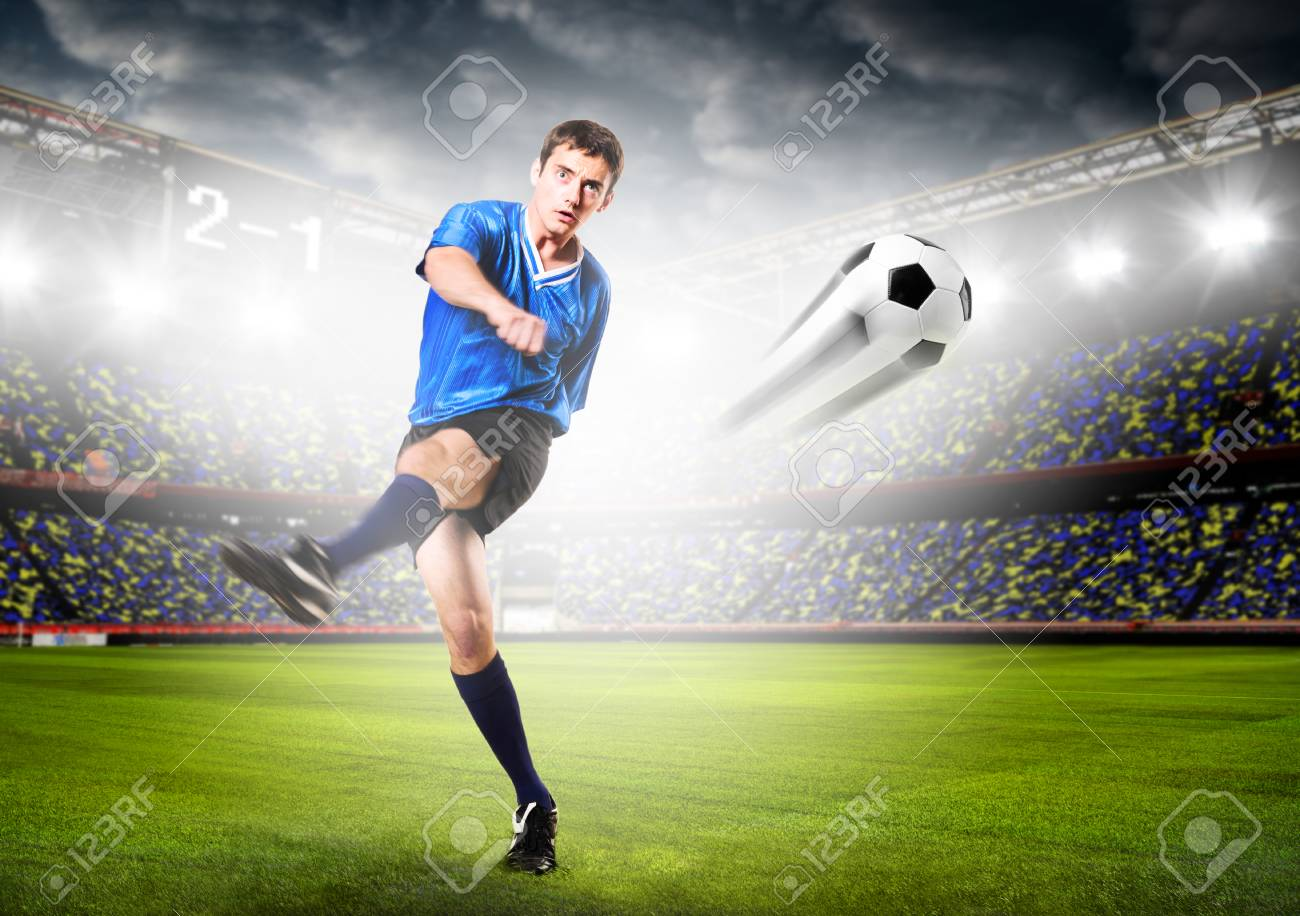 27c5bf5be soccer or football player is kicking ball on stadium Stock Photo - 28918440