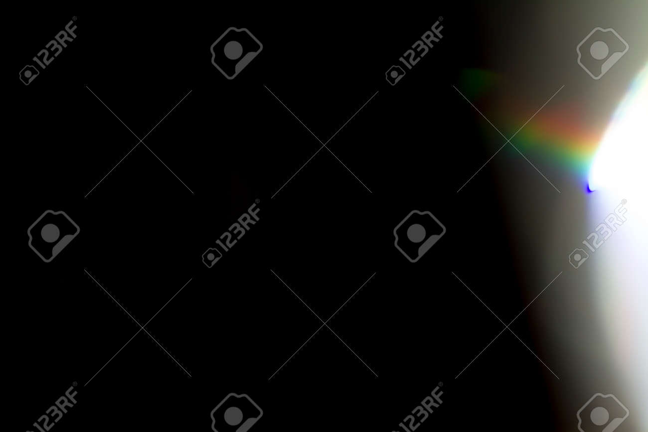 Colourful lens flare on black background. - 145444736