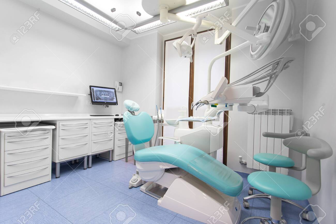 Dentist surgery room with dentist chair and tools, no people are visible. - 147542457