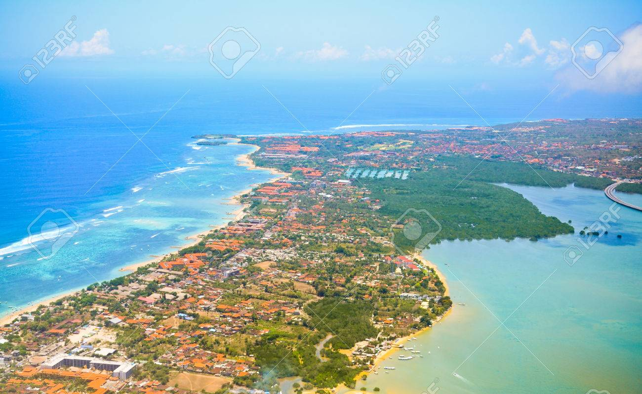 Sandy Coast Buildings And Blue Sea With Waves Bali Island View