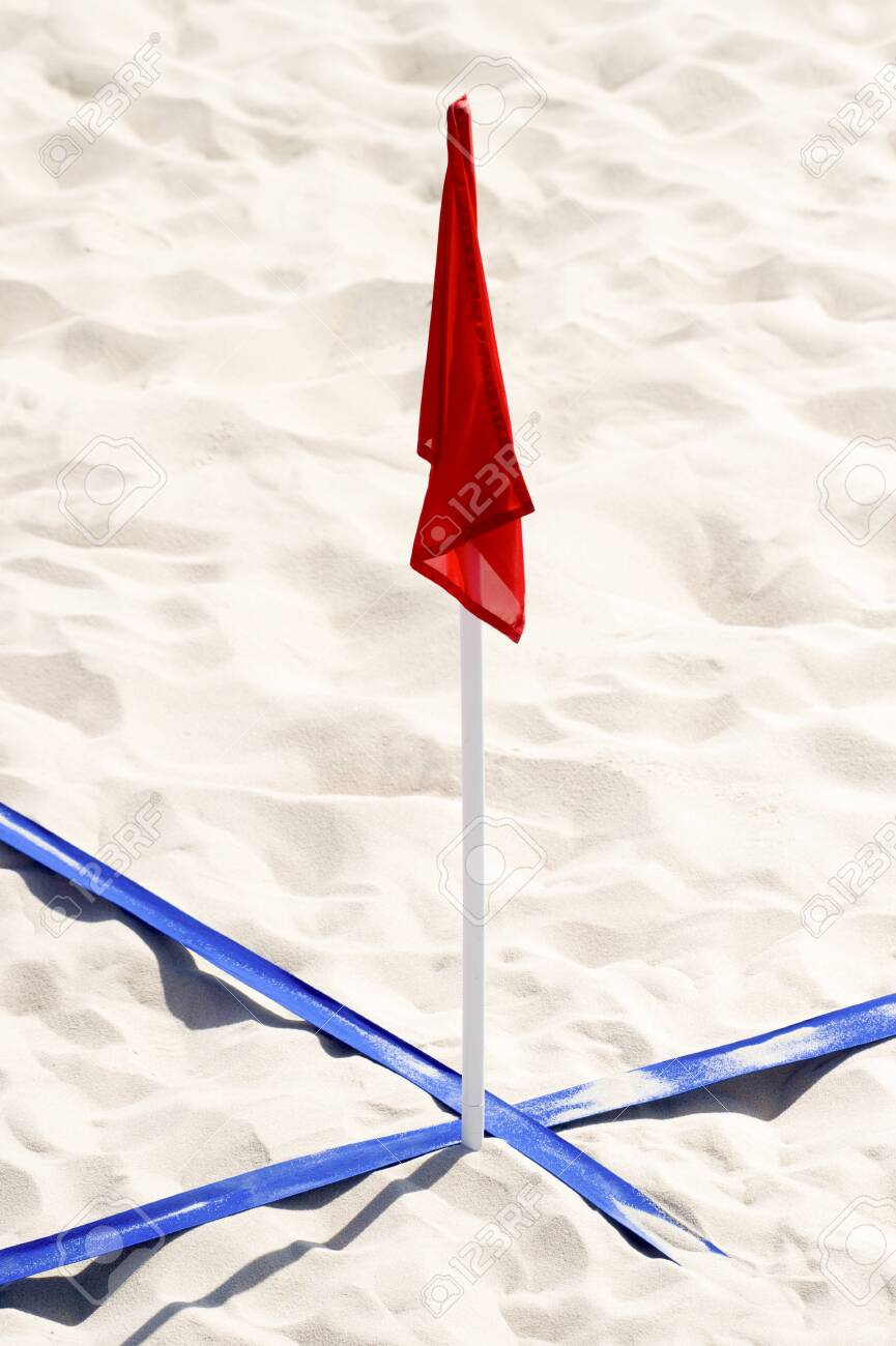 beach soccer court up close and in detail with blue plastic line marker and red flag - 126985509
