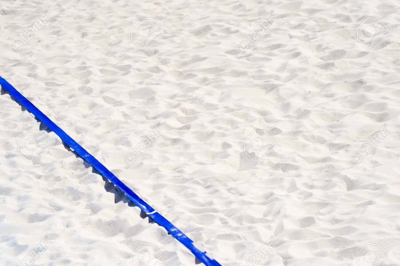 beach volleyball, soccer, handball court up close and in detail with blue plastic line marker - 126986584
