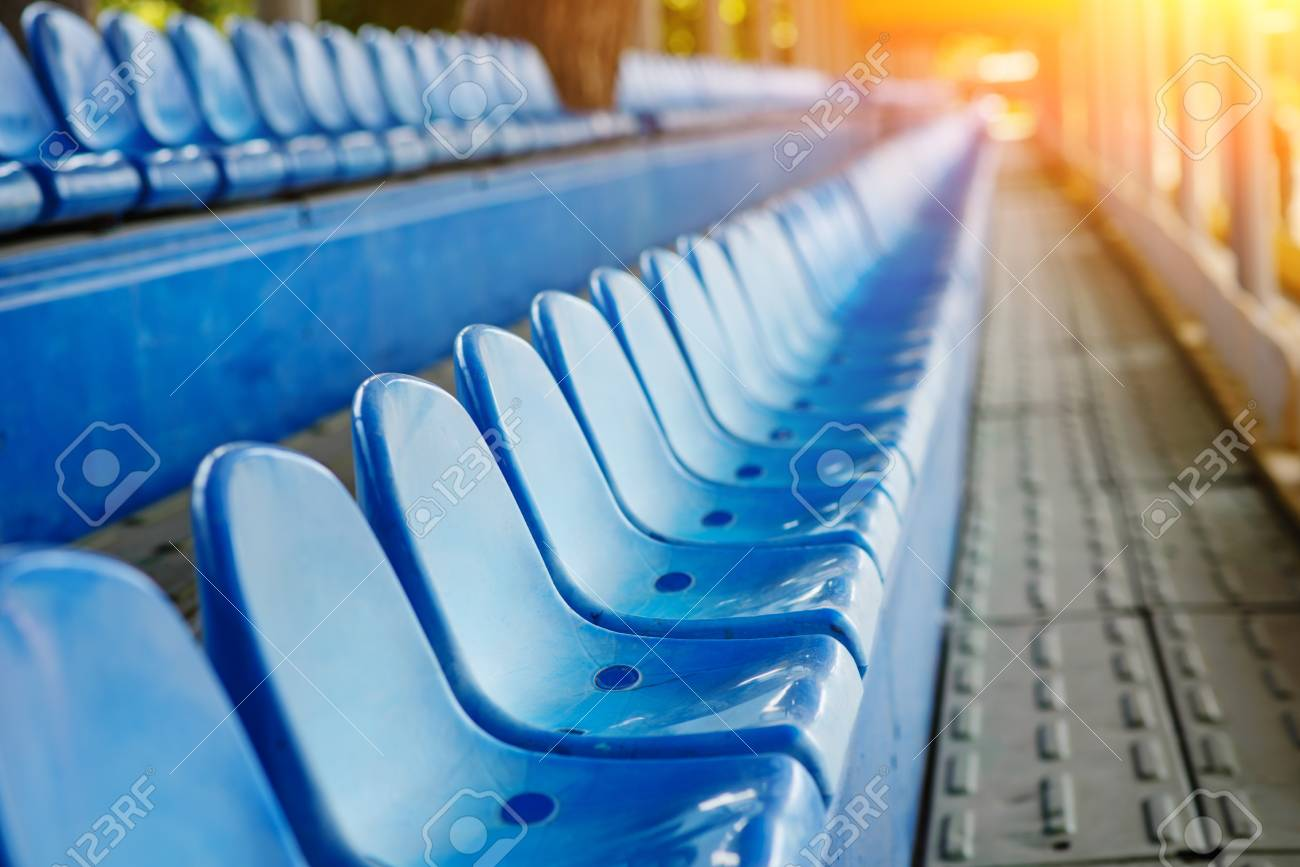 Empty plastic chairs in the stands of the stadium. - 110751069