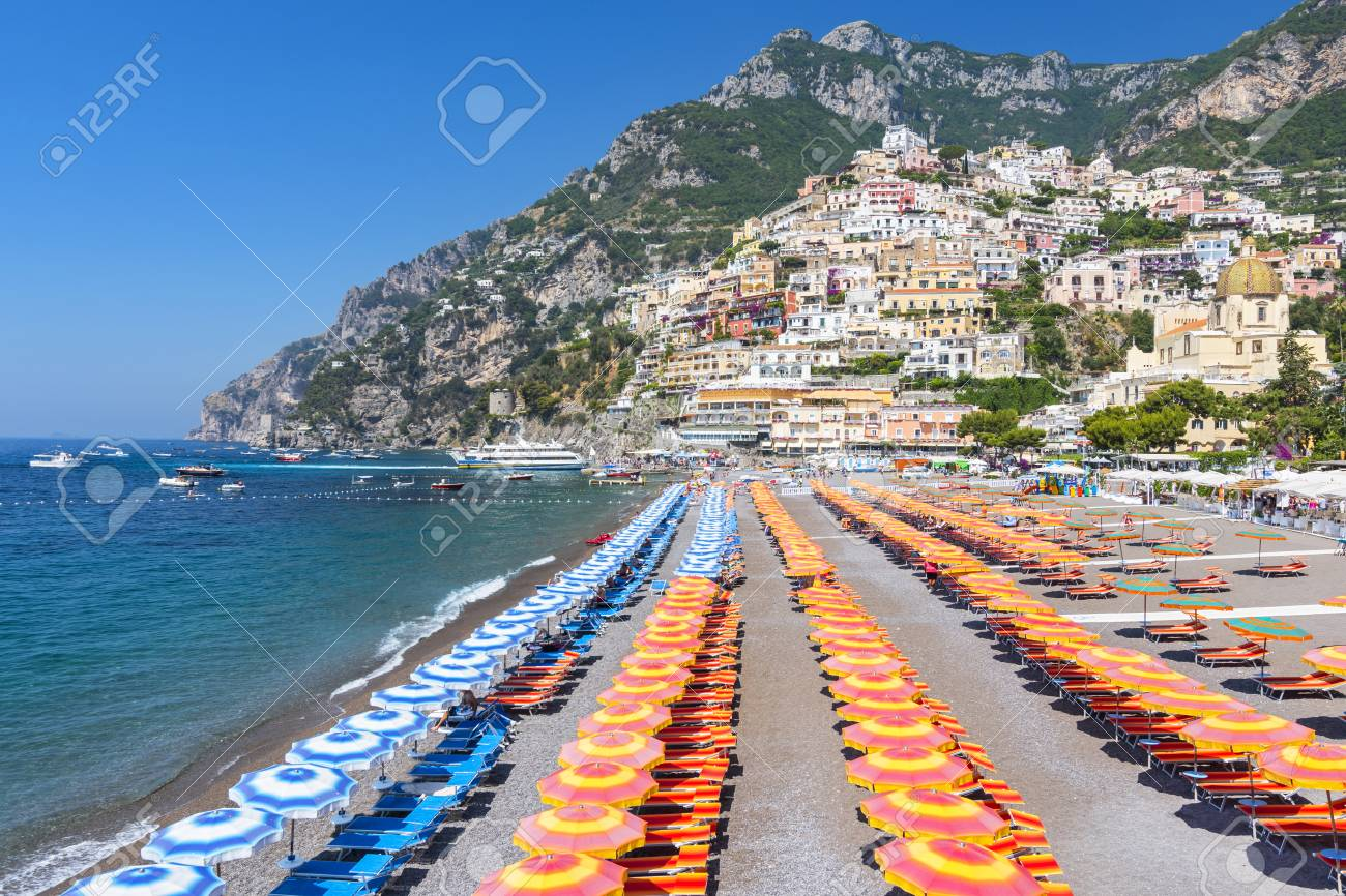 View Of Famous Rows Of Blue And Orange Beach Umbrellas On Positano
