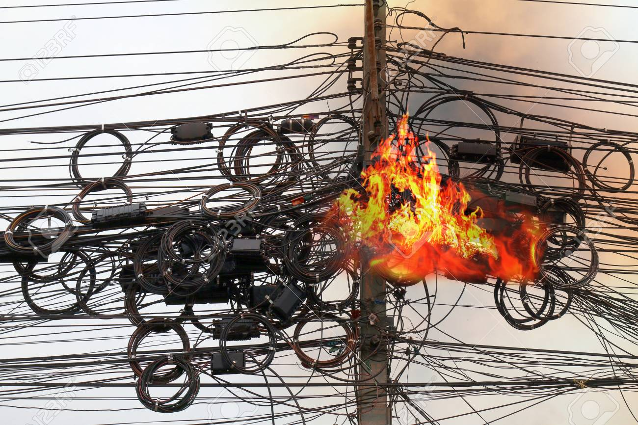 Fire Is Burning At High Voltage Cables Power, Danger Wire Tangle.. Stock  Photo, Picture And Royalty Free Image. Image 97615597.