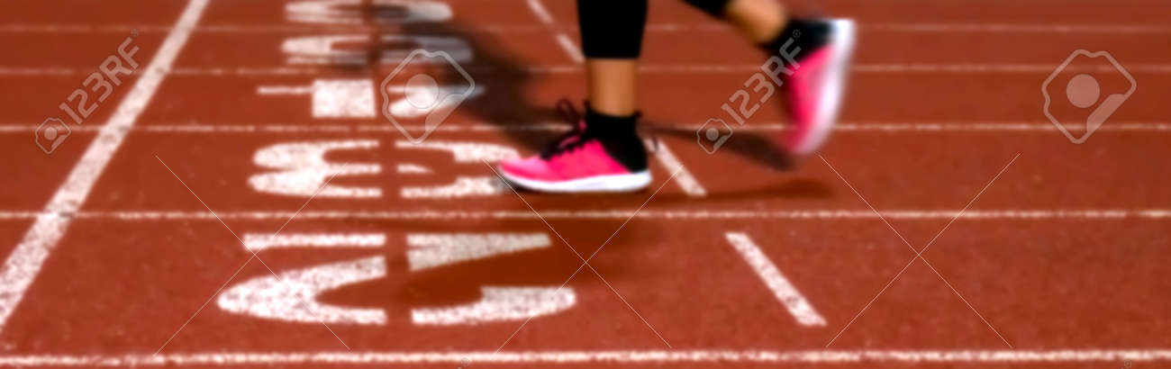 blurred athlete are jogging or walk at the start track stadium, running exercise concept - 169183492