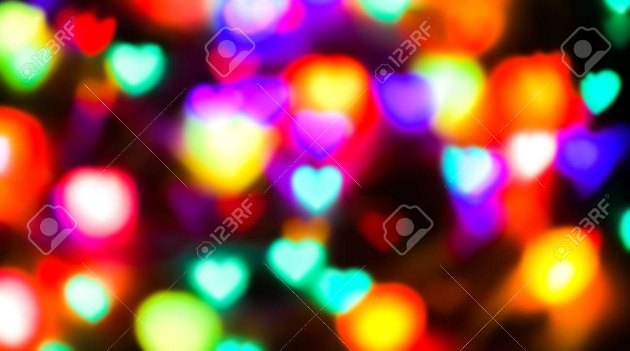 heart shape colorful light blurred for valentine's day background, colorful heart bokeh in dark night, glowing light with heart shape bokeh for abstract background - 169183493
