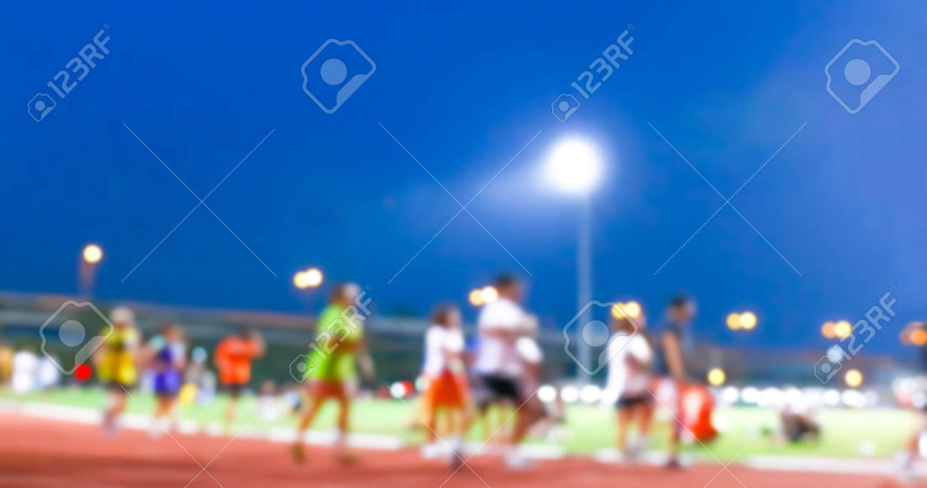 blurred people walking and jogging run for exercise at the outdoor stadium - 169183496