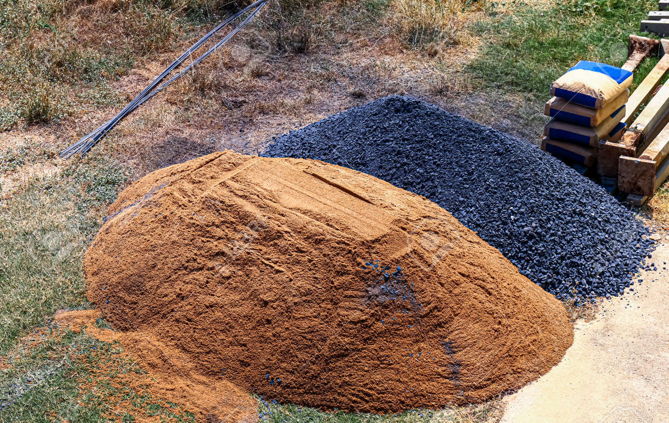 stone and sand pile at construction area, construction concept - 169183442