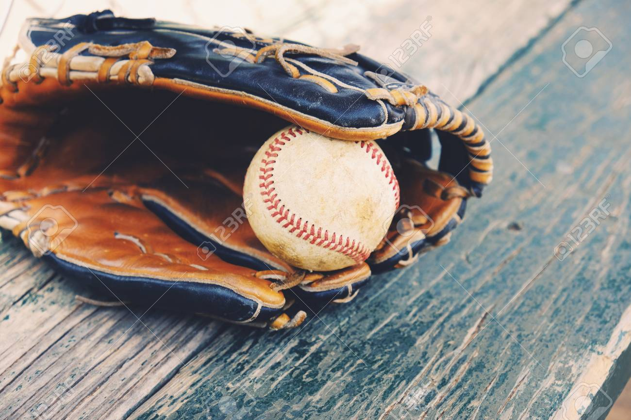 Awesome Baseball In Game Glove On Wood Dugout Bench Ocoug Best Dining Table And Chair Ideas Images Ocougorg