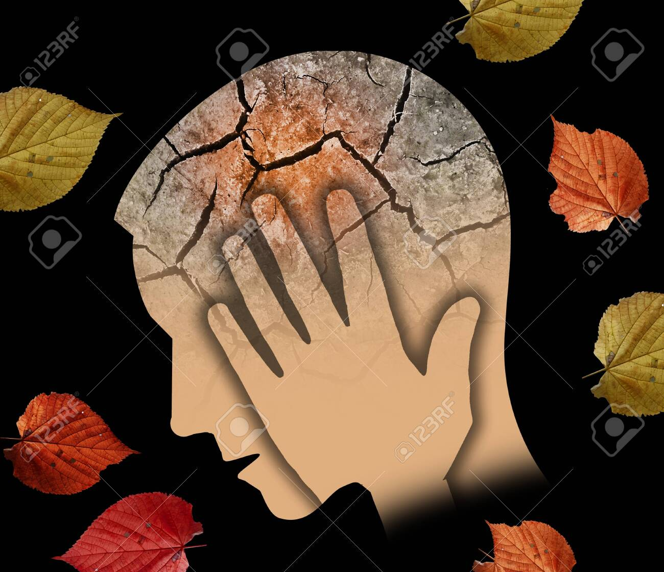 Autumn sadness and depression, young man. Stylized Male Head Silhouette Holding His Head.Photo-montage with Dry Cracked Earth and Autumn Leaves Symbolizing Depression. - 131422096