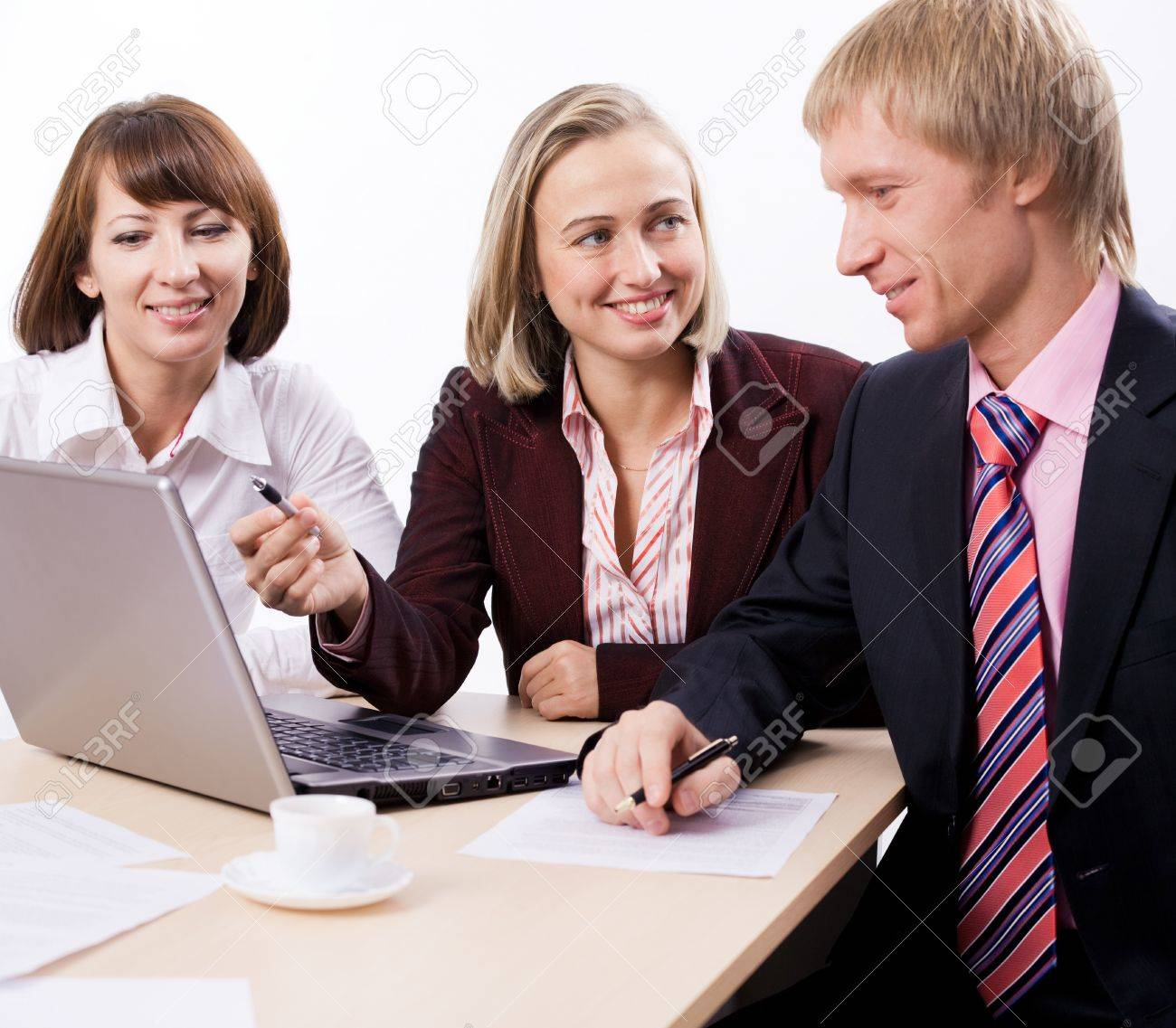 Business people sit at � table and communicate Stock Photo - 4207644