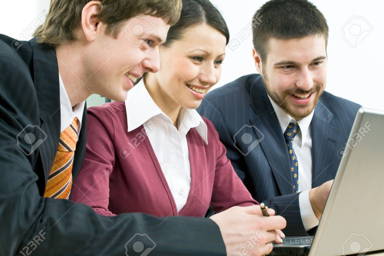Three businesspeople discussing computer work Stock Photo - 4231318