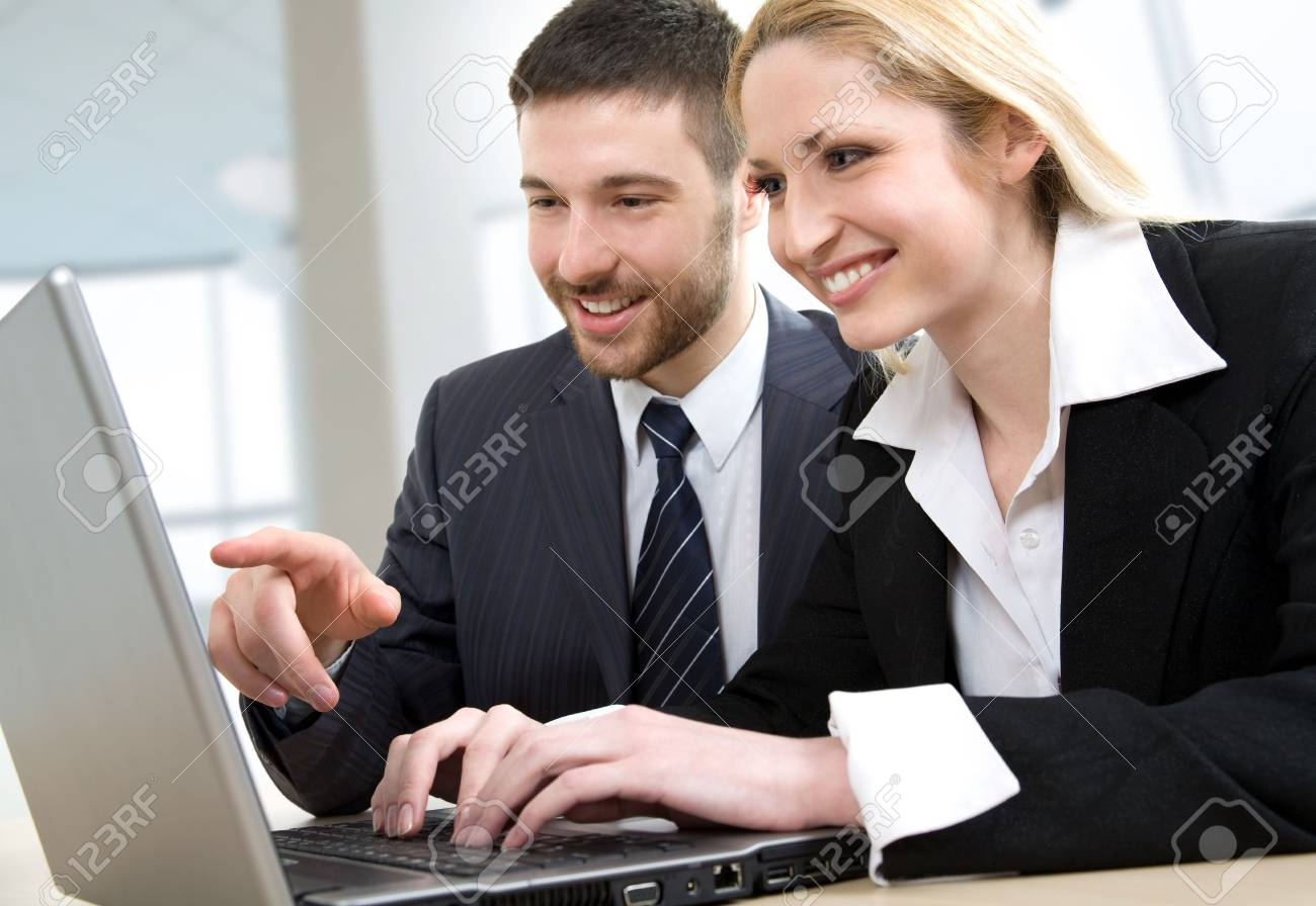 A businessman and a businesswoman at work on the laptop computer Stock Photo - 4765448