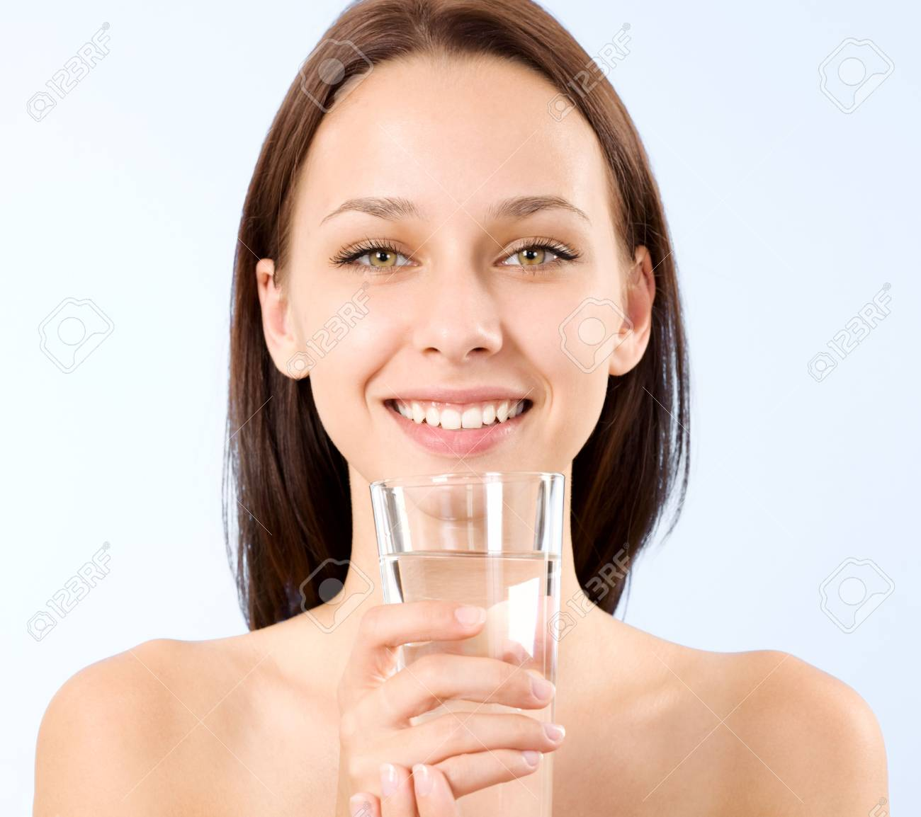 a beautiful young woman holding a glass of water Stock Photo - 6666256