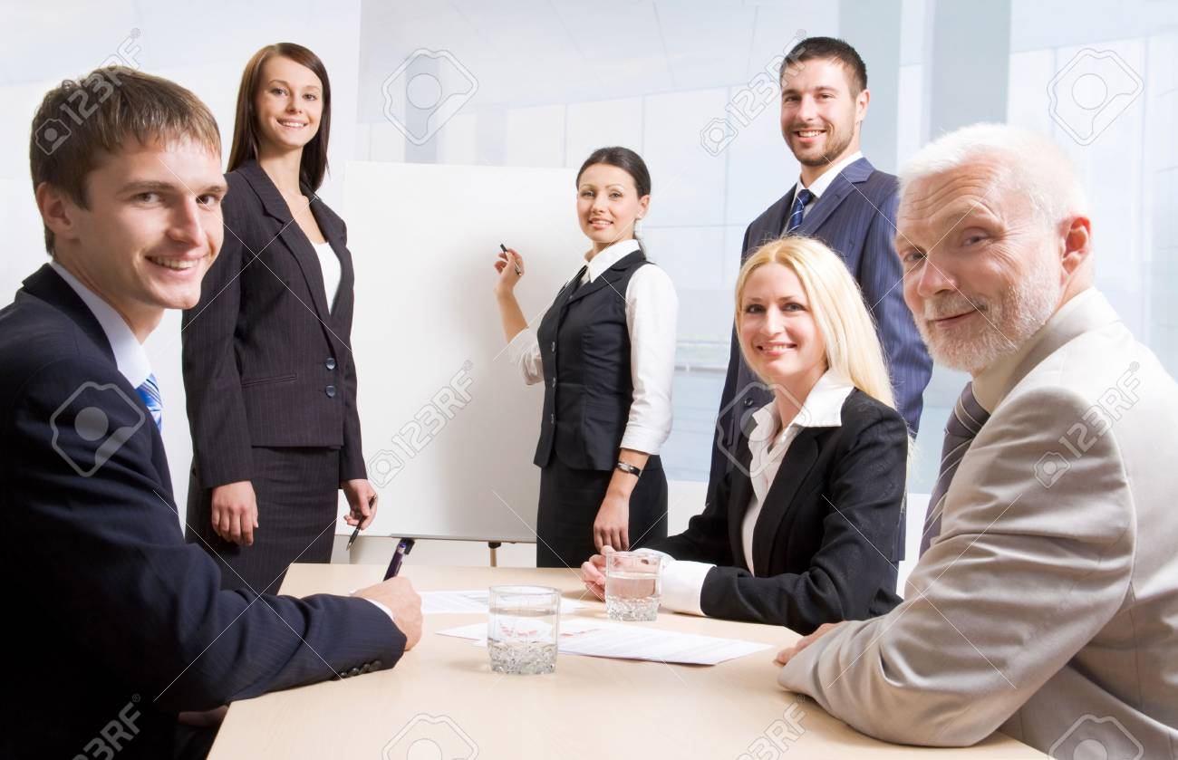 Group of business people in a modern office Stock Photo - 6666303
