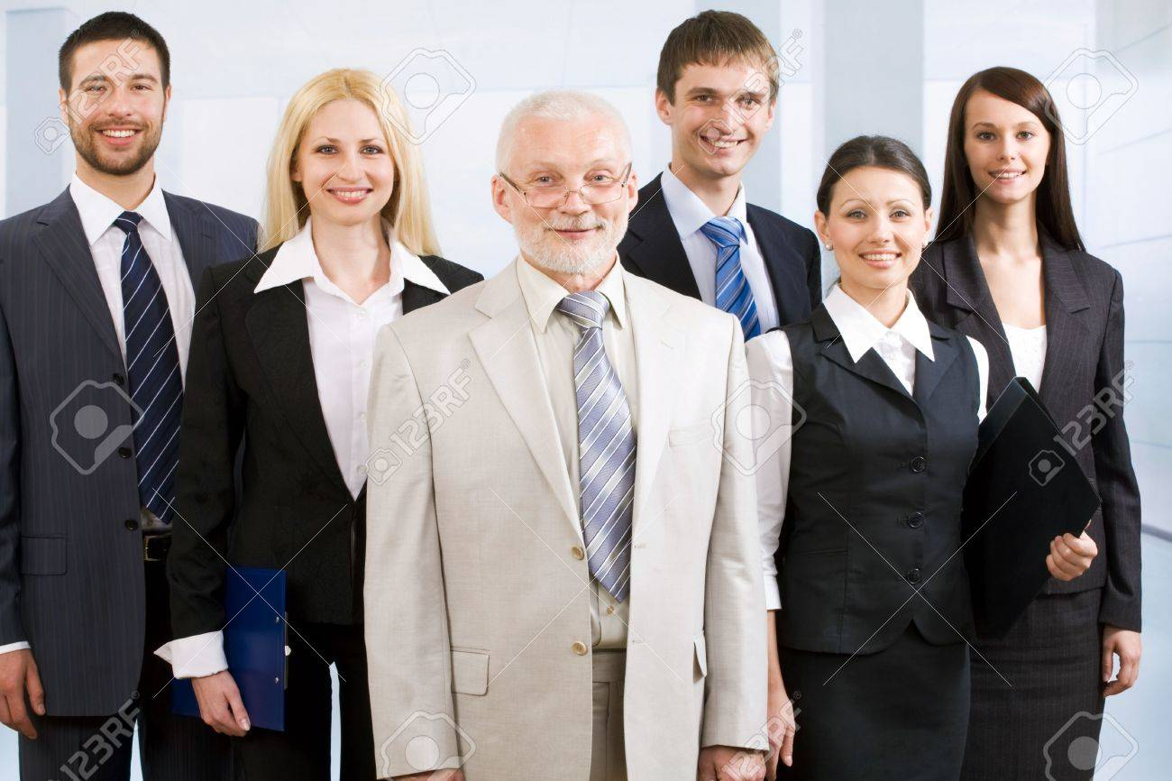 Cheerful business people standing together and their elderly boss Stock Photo - 6683102