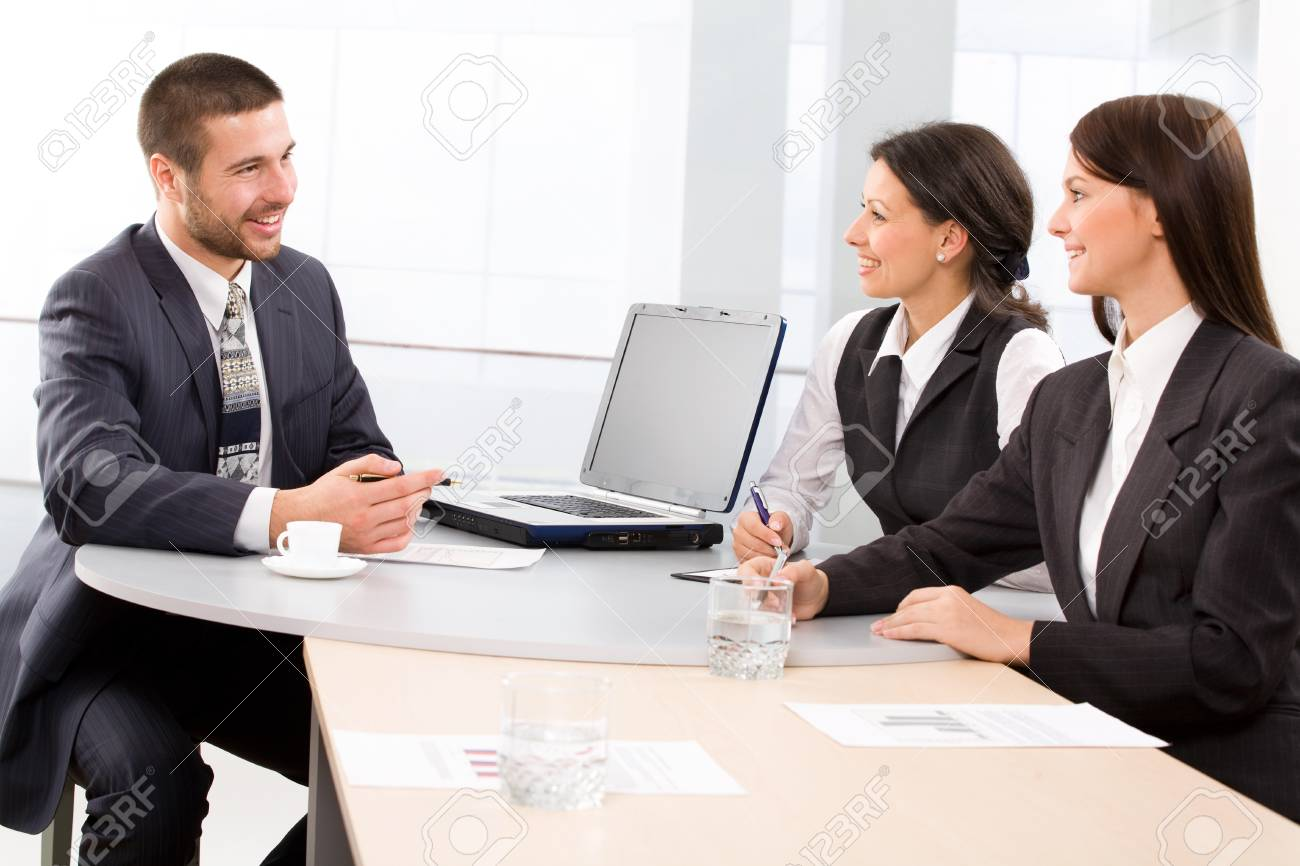 Three colleagues working  in the office Stock Photo - 9265157