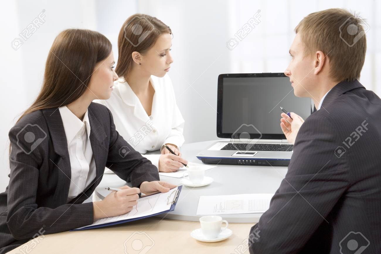 Three successful colleagues working  in the office Stock Photo - 9335423