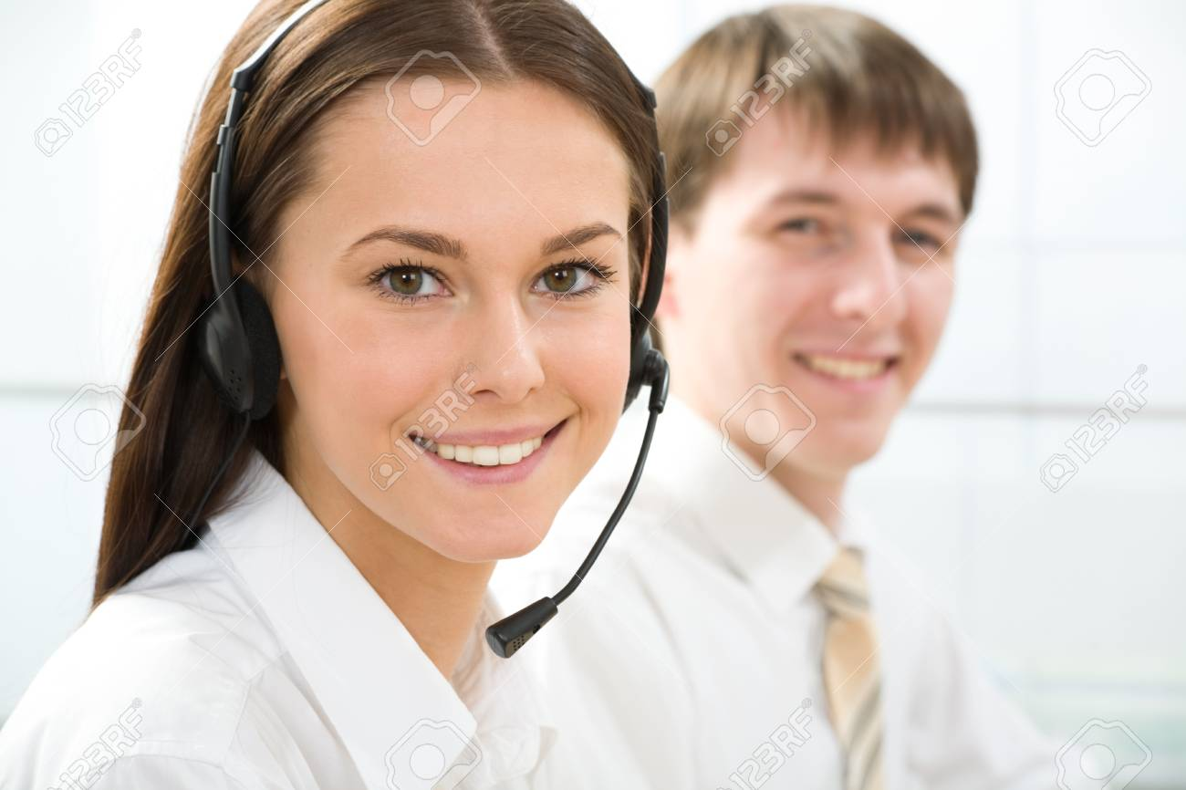 Portrait of beautiful telephone operator  looking at camera in working environment Stock Photo - 9808191