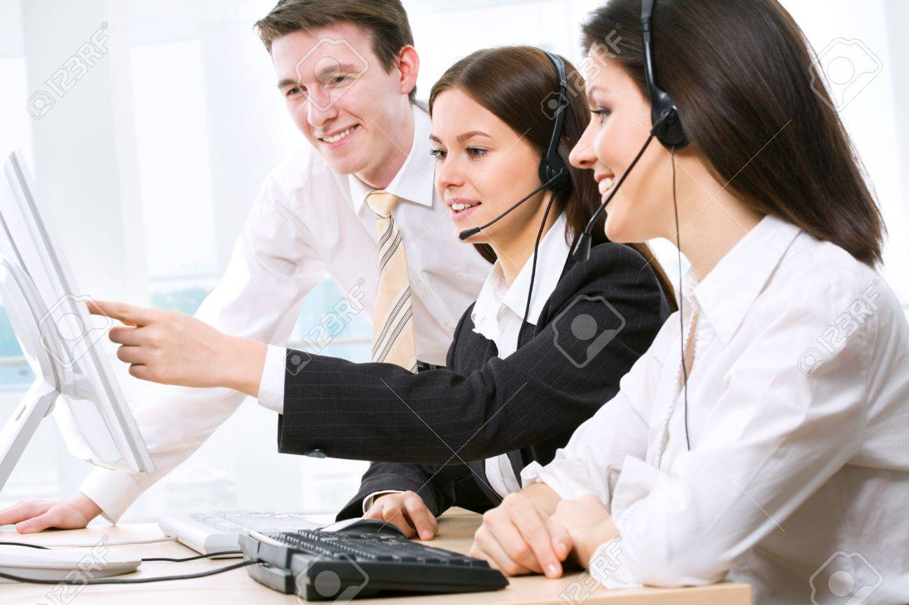 Telephone operators looking at the monitors and working Stock Photo - 10011690